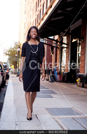 Black Business Woman stock photo, An African American business woman in an urban setting. by Tyler Olson