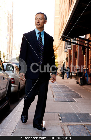 Candid Business Man  stock photo, A business man in a city setting on a sidewalk by Tyler Olson