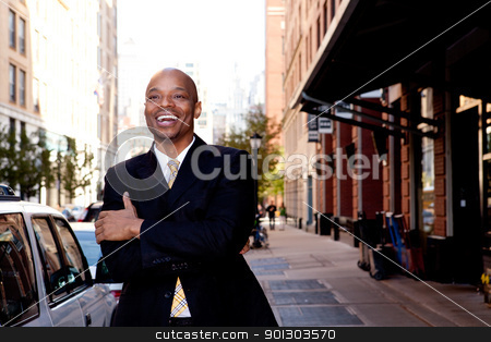 Laugh Business Man stock photo, A happy business man, downtown in a city by Tyler Olson