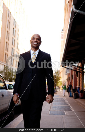 Business Portrait stock photo, A street portait of a busienss man walking down the sidewalk by Tyler Olson