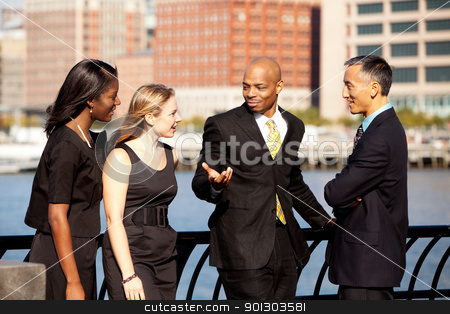 Business Team stock photo, A multicultural business team outside in discussion by Tyler Olson