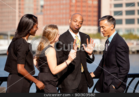 Business Discussion stock photo, A group of business people outdoors in a discussion by Tyler Olson