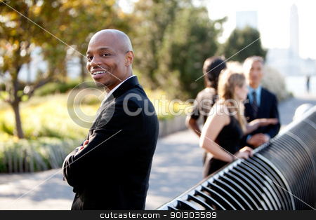 Business Team stock photo, A group of business colleagues in the park - focus on front man by Tyler Olson