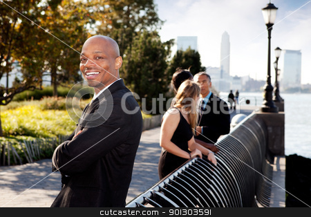 Business Portrait stock photo, An African American business man with a big smile by Tyler Olson