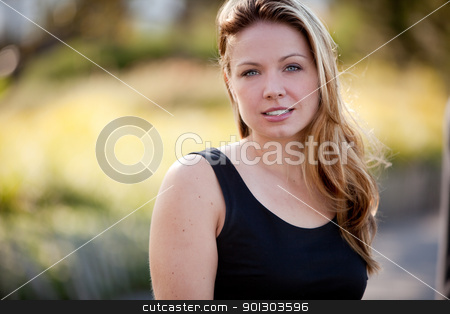 Beautiful Business Woman stock photo, A beautiful caucasian business woman in an outdoor setting by Tyler Olson
