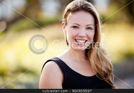 Happy Business Woman stock photo, A happy business woman isolated against a difuse background by Tyler Olson