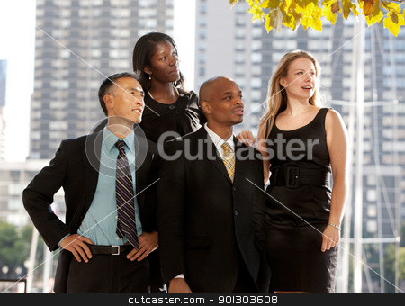 Business Team Looking to the Side stock photo, A business team looking to the side or into the distance by Tyler Olson