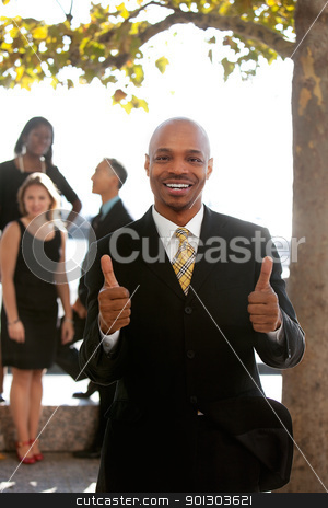 Two Thumbs Up stock photo, An african american business man with thumbs up by Tyler Olson