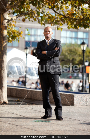 Business man stock photo, A business man in a city setting outside by Tyler Olson