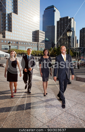 Business on the Move stock photo, A group of business people walking down town in a large city by Tyler Olson