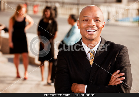 Business Man Laugh stock photo, An portrait of an African American Business Man in an outdoor setting by Tyler Olson