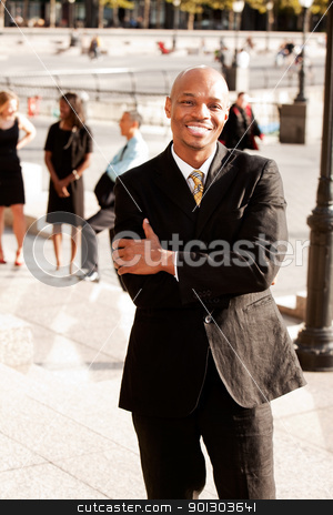 Outdoor Portrait stock photo, A portrait of a happy African American Business Man outdoors by Tyler Olson