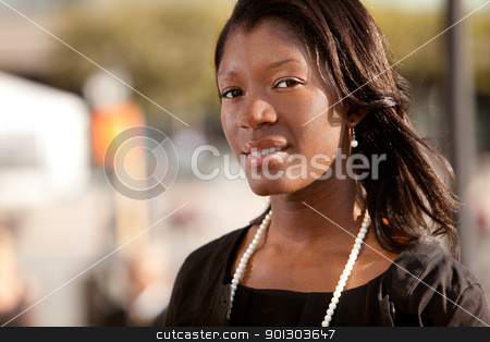 African American Business Woman stock photo, A portrait of an African American business woman outdoors by Tyler Olson