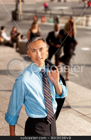 Casual Business Man stock photo, A casual candid portrait of an Asian looking business man by Tyler Olson