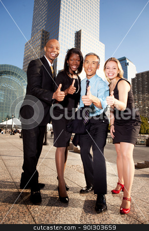 Business Thumbs Up stock photo, A group of business people giving a thumbs up sign by Tyler Olson