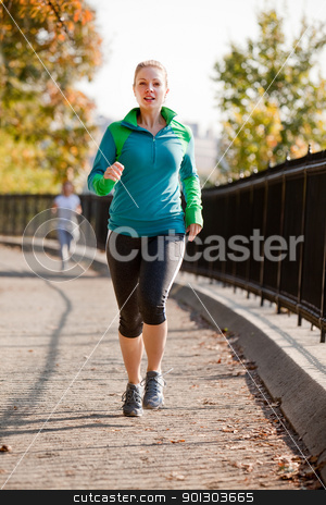 Woman Jog stock photo, A woman jogging in a park by Tyler Olson