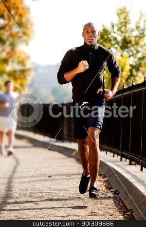 Man Jog stock photo, An African American jogging in a park in the morning by Tyler Olson