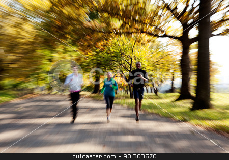 Park Jogging stock photo, Three people jogging in the park with zoom blur by Tyler Olson