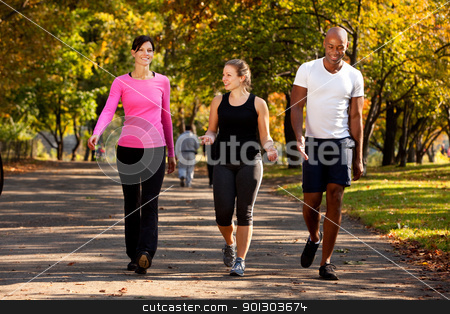 Walk Park stock photo, Three people walking in a park, getting some exercise by Tyler Olson