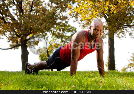 Park Exercise stock photo, An african american doing exercises in the park by Tyler Olson