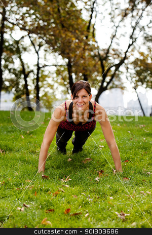 Push Ups stock photo, A caucasian female doing push ups in the park by Tyler Olson