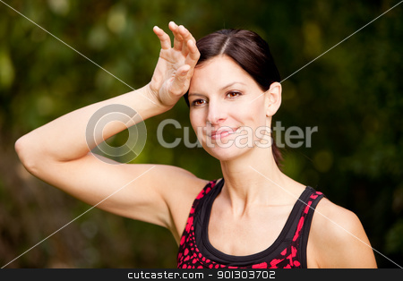 Woman Exercise stock photo, A woman exercising in a park, taking a break by Tyler Olson