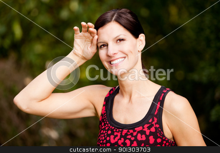 Fitness stock photo, A woman exercising in a park, taking a break by Tyler Olson