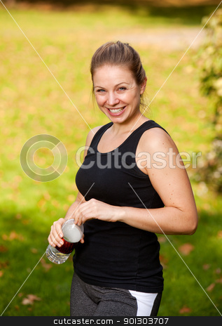 Park Fitness stock photo, A woman taking a break from exercising in the park by Tyler Olson