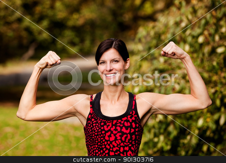 Female Fitness stock photo, A female fitness model flexing her biceps by Tyler Olson