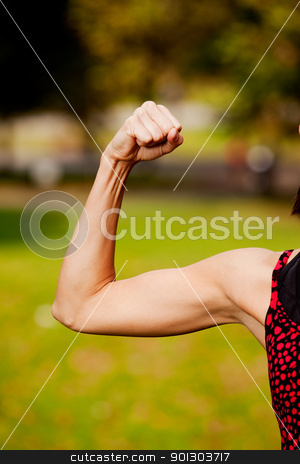 Female Bicep stock photo, A female flexing her bicep muscle by Tyler Olson