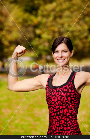 Fitness stock photo, A female fitness model flexing her bicep  by Tyler Olson