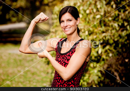 Muscle Woman stock photo, A woman flexing her biscep and making it larger by Tyler Olson