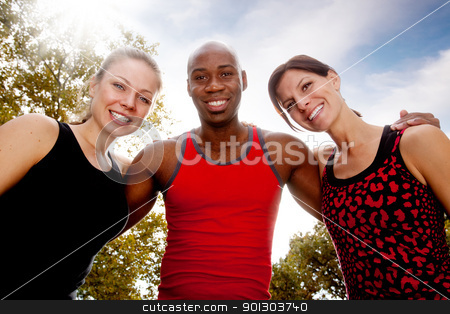Fitness Friends stock photo, A group of friends exercising in the park on a warm sunny day by Tyler Olson
