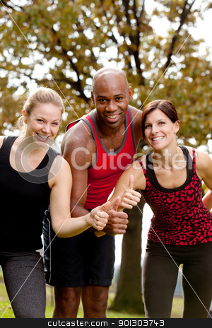 Happy Fitness stock photo, A group of people exercising in the park, giving a thumbs up to the camera by Tyler Olson