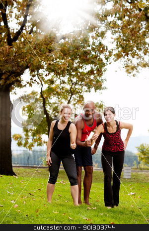 Exercise Park Happy stock photo, A group of friends exercising in the park - giving the thumbs up  by Tyler Olson