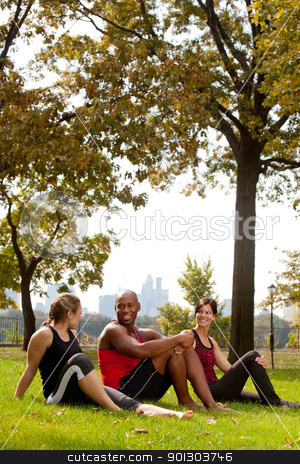 Park Relax stock photo, A group of people relaxing in the park after exercise by Tyler Olson