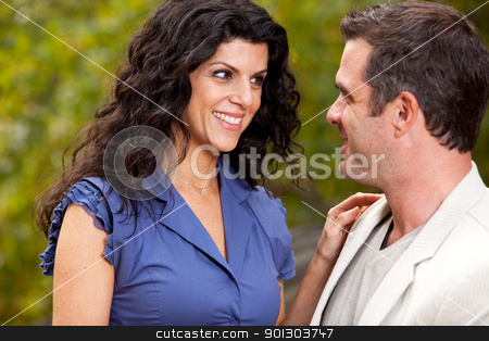 Happy Woman stock photo, A woman looking happy at her husband / boyfriend - Focus on the woman by Tyler Olson