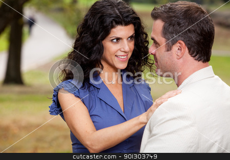 Happy Question stock photo, A woman looking at her husband with suspense by Tyler Olson