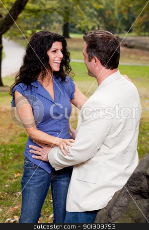 Laugh Couple stock photo, A happy couple in the park laughing and talking by Tyler Olson