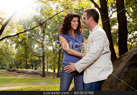 Happy Couple stock photo, A happy couple relaxing in the park by Tyler Olson