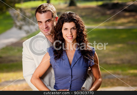 Married Couple Portrait stock photo, A portriat of a happy couple in the park. by Tyler Olson