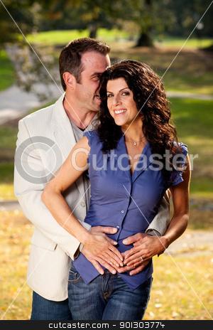Secret Whisper stock photo, A man whispering something in a woman's ear by Tyler Olson