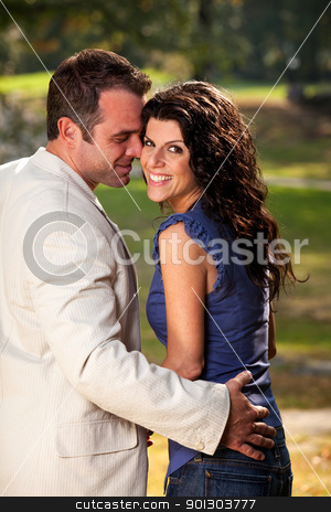 Happy Couple Flirt stock photo, A happy couple in the park having fun on a warm day by Tyler Olson