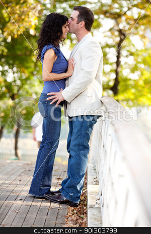 Park Kiss stock photo, A man kissing a woman on the forehead by Tyler Olson