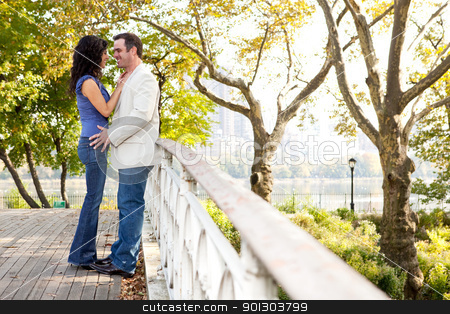 Smile Couple stock photo, A couple smiling and looking at eachother in a park by Tyler Olson