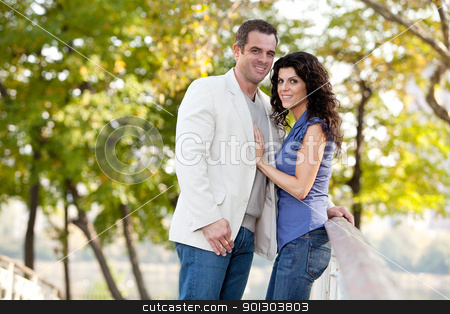 Couple Love stock photo, A couple looking at the camera and smiling by Tyler Olson