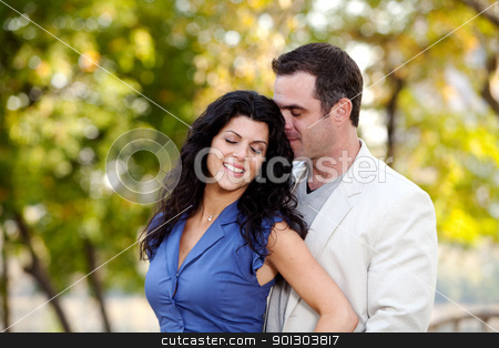 Love Couple stock photo, A man and woman showing affection in a park by Tyler Olson