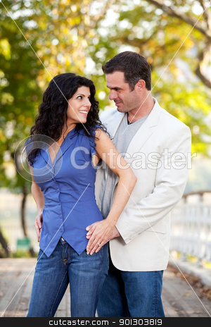 Couple Portrait stock photo, A portrait of a happy couple in the park by Tyler Olson