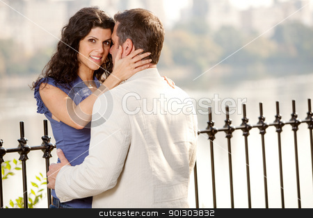 Couple Hug stock photo, A couple hugging in the park - eye contact with the female by Tyler Olson