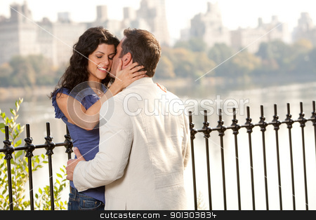 Kiss stock photo, A man and woman kissing in the park by Tyler Olson